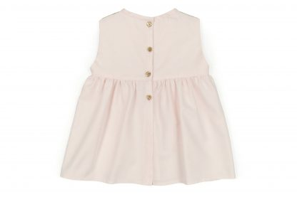 Vista trasera de la blusa lencera, color rosa claro, modelo Rose