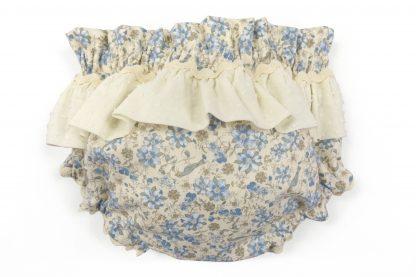 Vista trasera culotte estampado flores y pájaros tonos azules con detalle volante plumeti marfil. Modelo Blue Birds.