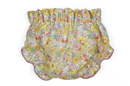 Vista trasera culotte liberty en tonos rosa, verde y amarillo.