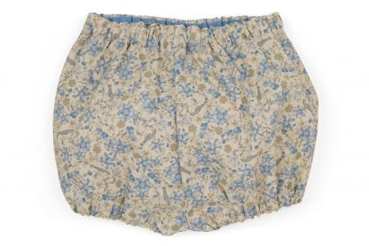 vista trasera bombacho estampado flores y pajaros en marfil y azul